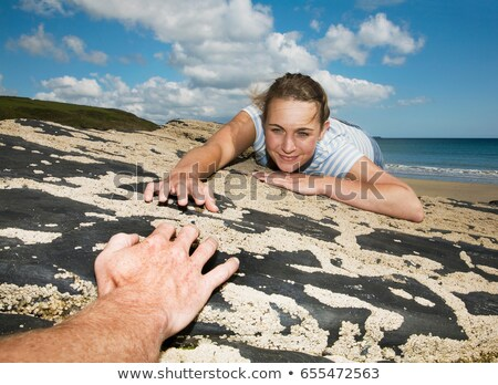 Woman Reaching across rocks to man Stock photo © IS2