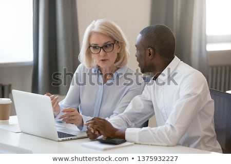 affiliate marketing on laptop in meeting room stock photo © tashatuvango