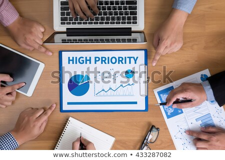 high priority on blue office folder toned image stock photo © tashatuvango