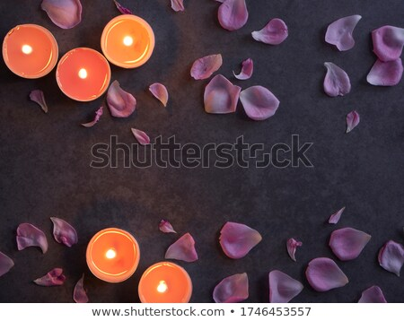 romantic candles and rose petals stock photo © rogistok