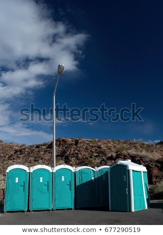Potable toilets by rocks Stock photo © IS2