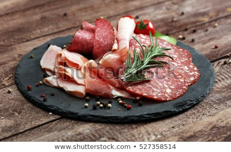 Plate of salami and cured meat on table Stock photo © IS2