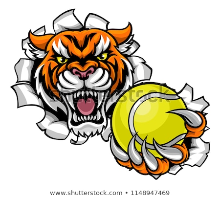 Stock photo: Tiger Holding Tennis Ball Breaking Background
