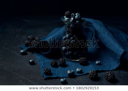 Blueberry scattering out of jug  Stock photo © dash