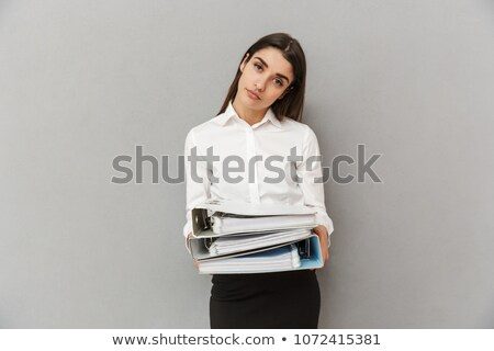 Photo of tired woman in white shirt and black skirt holding docu Stock photo © deandrobot