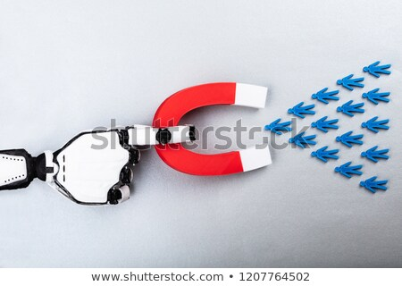 Robot Attracting Human Figures With Horseshoe Magnet Stock photo © AndreyPopov