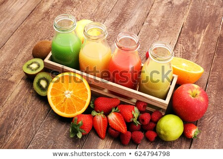 Bottle of fresh organic apple and raspberry juice with fresh fruits in box on wooden background with Stock photo © DenisMArt