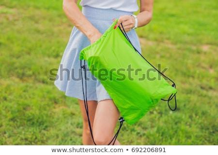 A woman tries to inflate an air sofa stock photo © galitskaya