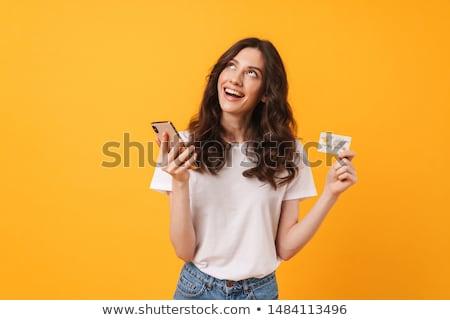 Feliz mulher jovem posando isolado amarelo parede Foto stock © deandrobot