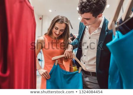 Paar hunkering nieuwe kleding mode winkelen Stockfoto © Kzenon