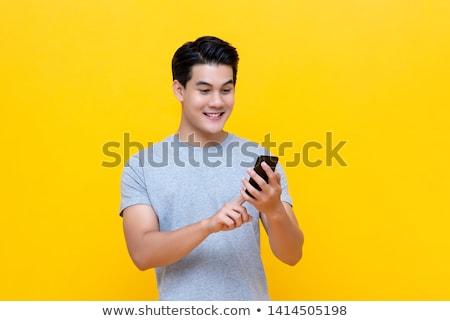 boldog · fickó · mobiltelefon · otthon · ül · nappali - stock fotó © deandrobot