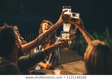 Young friends with beer Stock photo © pressmaster