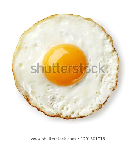 Fried eggs in frying pan Stock photo © YuliyaGontar