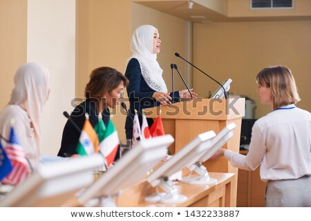 Stockfoto: Young Contemporary Female Delegate In Hijab And Suit