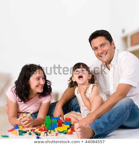 happy family playing with colorful blocks at home stock photo © dashapetrenko
