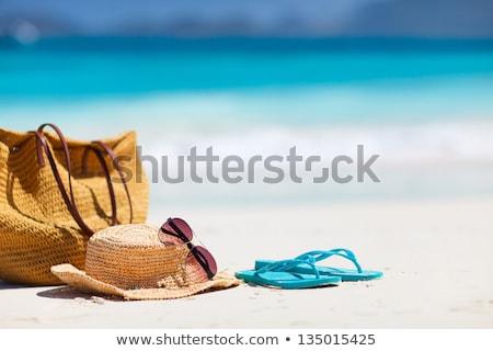 Szalmakalap napszemüveg tengerparti homok nyár ünnepek vakáció Stock fotó © dolgachov