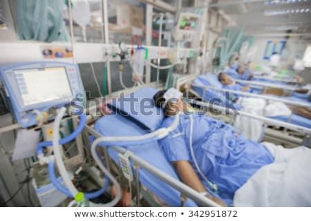 Vrouwelijke patiënt intensief zorg eenheid kliniek Stockfoto © Kzenon