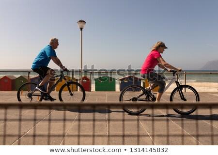 Yandan görünüş aktif kıdemli kadın binicilik bisiklet Stok fotoğraf © wavebreak_media
