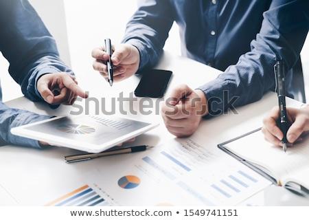 Team financiële gegevens afgedrukt uit charts Stockfoto © Kzenon