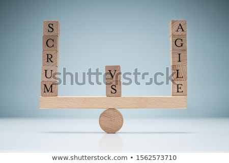 Stack Of Wooden Scrum And Agile Blocks On Seesaw Stock photo © AndreyPopov