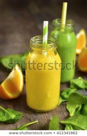 Sok pomarańczowy szkła butelek papieru napojów strony Zdjęcia stock © dolgachov