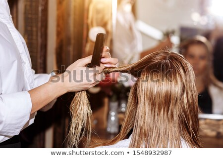 Happy young beautiful woman using hairdryer after washing her long blond hair Stock photo © pressmaster