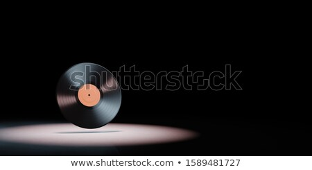 Vinyl Record Spotlighted on Black Background Stock photo © make
