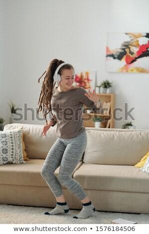 Jonge vrolijk energiek vrouwelijke dansen muziek Stockfoto © pressmaster