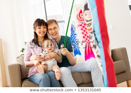 mixed-race family with koinobori carp streamer Stock photo © dolgachov
