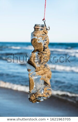 used plastic bottle in a fish hook