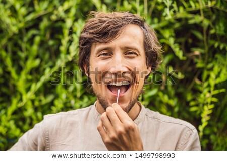 Człowiek DNA test bawełny domu lekarza Zdjęcia stock © galitskaya