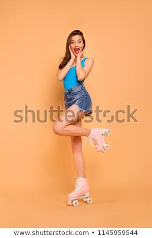 Good fun for long legged girl roller skating Stock photo © darrinhenry