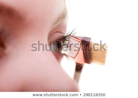 Beautiful girl using eye lash separator brush Stock photo © darrinhenry