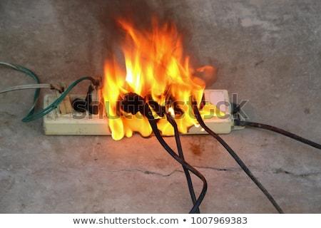elétrico · sobrecarga · perigoso · poder · fogo · tecnologia - foto stock © Rambleon