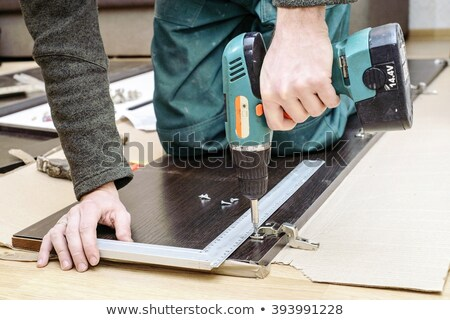 a carpenter working on a closet door stock photo © photography33