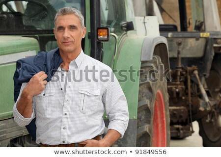 farmer posing in front of a tractor Stock photo © photography33