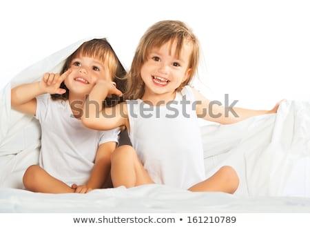 Iki gülen çocuklar yatak kardeş yukarı Stok fotoğraf © michey