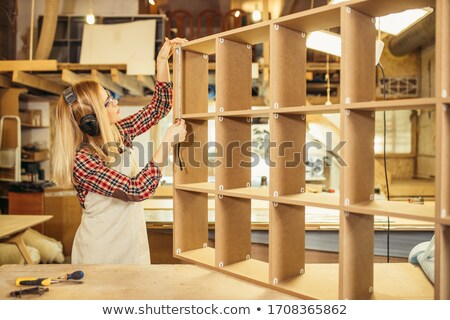 Stock photo: female carpenter carrying plank of wood