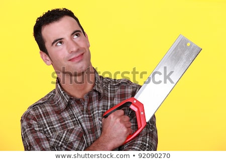 Smiling man with a tenon saw Stock photo © photography33