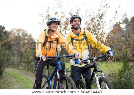 カップル · バイク · 屋外 · 笑みを浮かべて · 男 · 自転車 - ストックフォト © photography33