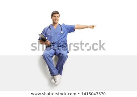 Full length of young nurse pointing blank clipboard stock photo © get4net