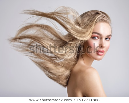 woman with hair lightly fluttering in the wind Stock photo © feedough