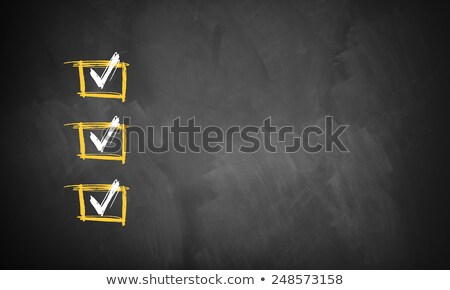 Check boxes with ticks on a blackboard background Stock photo © bbbar