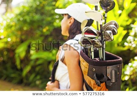 Donna sacca da golf sorriso legno golf bag Foto d'archivio © photography33