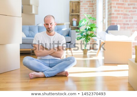 Grumpy man sitting on the floor Stock photo © photography33
