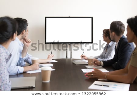 group of people watching a screen Stock photo © photography33