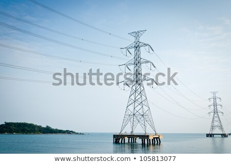High voltage power pole in the sea Stock photo © rufous