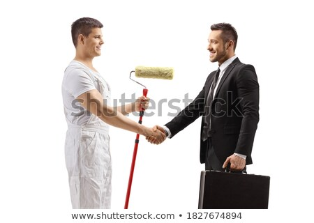 Decorator shaking hands with a young man Stock photo © photography33