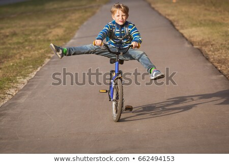 Sport boy with a bicycle outside Stock photo © OleksandrO