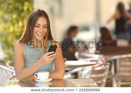 笑みを浮かべて · 女性 · 携帯電話 · コーヒーカップ · 幸せ · 笑顔 - ストックフォト © LynneAlbright